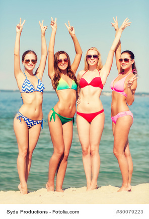 summer vacation, holidays, gesture, travel and people concept - group of smiling young women showing peace or victory sign on beach